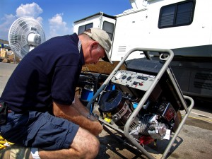 Man outside working on a portable generator